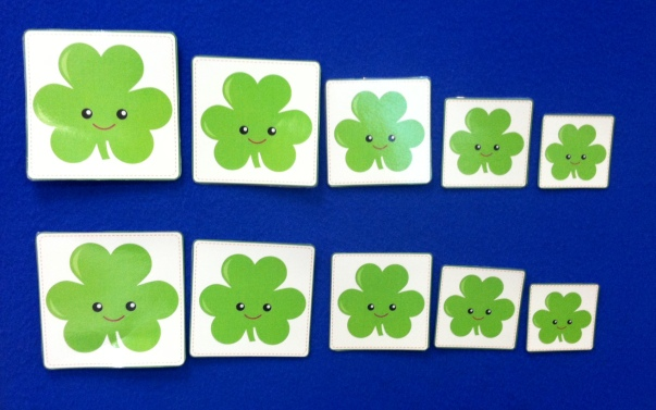 five green shamrocks