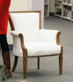 Reupholstered in white cotton duck.